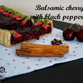 Balsamic cherry pie with black pepper crust.
